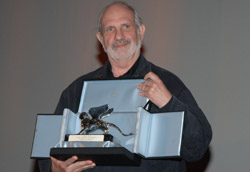 """Brian De Palma premiato a Venezia per <i>Redacted</i>"""" />Con tutte le giurie e i giurati presenti a Venezia, abbiamo voluto giocare anche noi ed eleggere il nostro film preferito della Mostra, che si è rivelato essere <em>Redacted</em> di Brian De Palma.</p> <p>1. <strong>Redacted</strong><br /> di Brian De Palma <strong>8,60</strong><br /> (ab 8, ds 7, fb 9, mm 9, ss 10)<br /> 2. <strong>La Graine et le mulet</strong><br /> di Abdellatif Kechiche <strong>8.25</strong><br /> (ab 8, gr 9, mm 8, ss 8)<br /> 3. <strong>Nightwatching</strong><br /> di Peter Greenaway <strong>8.20</strong><br /> (ab 8, fb 8, mm 8, ss 9, tc 8)<br /> 4. <strong>The Darjeeling Limited</strong><br /> di Wes Anderson <strong>8.16</strong><br /> (ab 9, fb 8, gr 7, mm 9, ss 8, tc 8)<br /> 5. <strong>Lust, Caution</strong><br /> di Ang Lee <strong>8.00</strong><br /> (ds 9, mm 8, ss 7) </p> <p>• <strong>12</strong> di Nikita Mikalkhov <strong>7.66</strong> (ab 8, fb 7, mm 8)<br /> • <strong>I'm not There</strong> di Todd Haynes <strong>7.50</strong> (ab 7, ds 7, fb 7, mm 8, ss 8, tc 8)<br /> • <strong>In the Valley of Elah</strong> di Paul Haggis <strong>7.33</strong> (ab 7, ds 8, fb 7, mm 8, ss 8, tc 6)<br /> • <strong>Sleuth</strong> di Kenneth Branagh <strong>7.20</strong> (ab 7, ds 8, fb 6, mm 8, ss 7)<br /> • <strong>Atonement</strong> di Joe Wright <strong>7.20</strong> (ab 7, ds 7, fb 7, mm 7, ss 8)<br /> • <strong>Mad Detective</strong> di Johnny To <strong>7.16</strong> (ab 8, fb 6, gr 8, mm 7, ss 8, tc 6)<br /> • <strong>It's a Free World</strong> di Ken Loach <strong>7.00</strong> (ab 9, ds 6, fb 6, mm 8, ss 6)<br /> • <strong>Chaos</strong> di Youssef Chahine <strong>7.00</strong> (ab 7, gr 7, mm 7)<br /> • <strong>Les Amours d'Astrée et de Céladon</strong> di Eric Rohmer <strong>7.00</strong> (gr 7, mm 7)<br /> • <strong>Sukiyaki Western Django</strong> di Takashi Miike <strong>6.33</strong> (ab 7, ds 6, fb 6, gr 7, mm 5, ss 7)<br /> • <strong>Il dolce e l'amaro</strong> di Andrea P"""